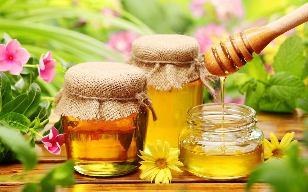jars of honey with flowers